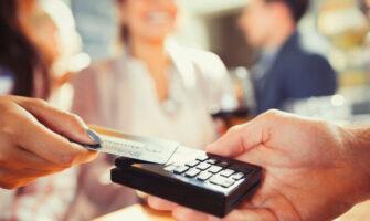 Close up Image of A Hand Using Credit Card Swiping Machine.