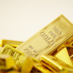 Gold Bars On White Background.