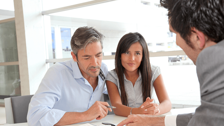 A Couple Customers Go-Through The Privileges & Instructions of Loan Documents.