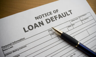 An Image Of A Notice of Loan Default Placed On The Table.